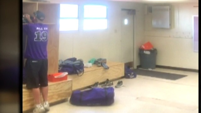 Locker room video shows football coach accused of stealing from player